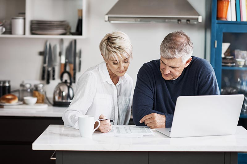 Couple reviewing bills and payments