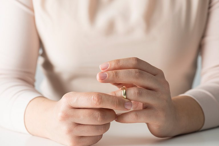 Woman Removing her Wedding Ring for her Divorce