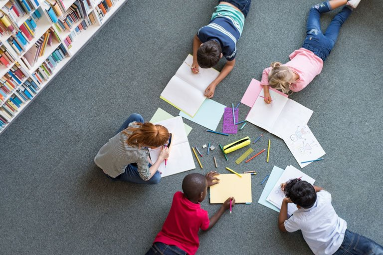 Kids Drawing in a Library