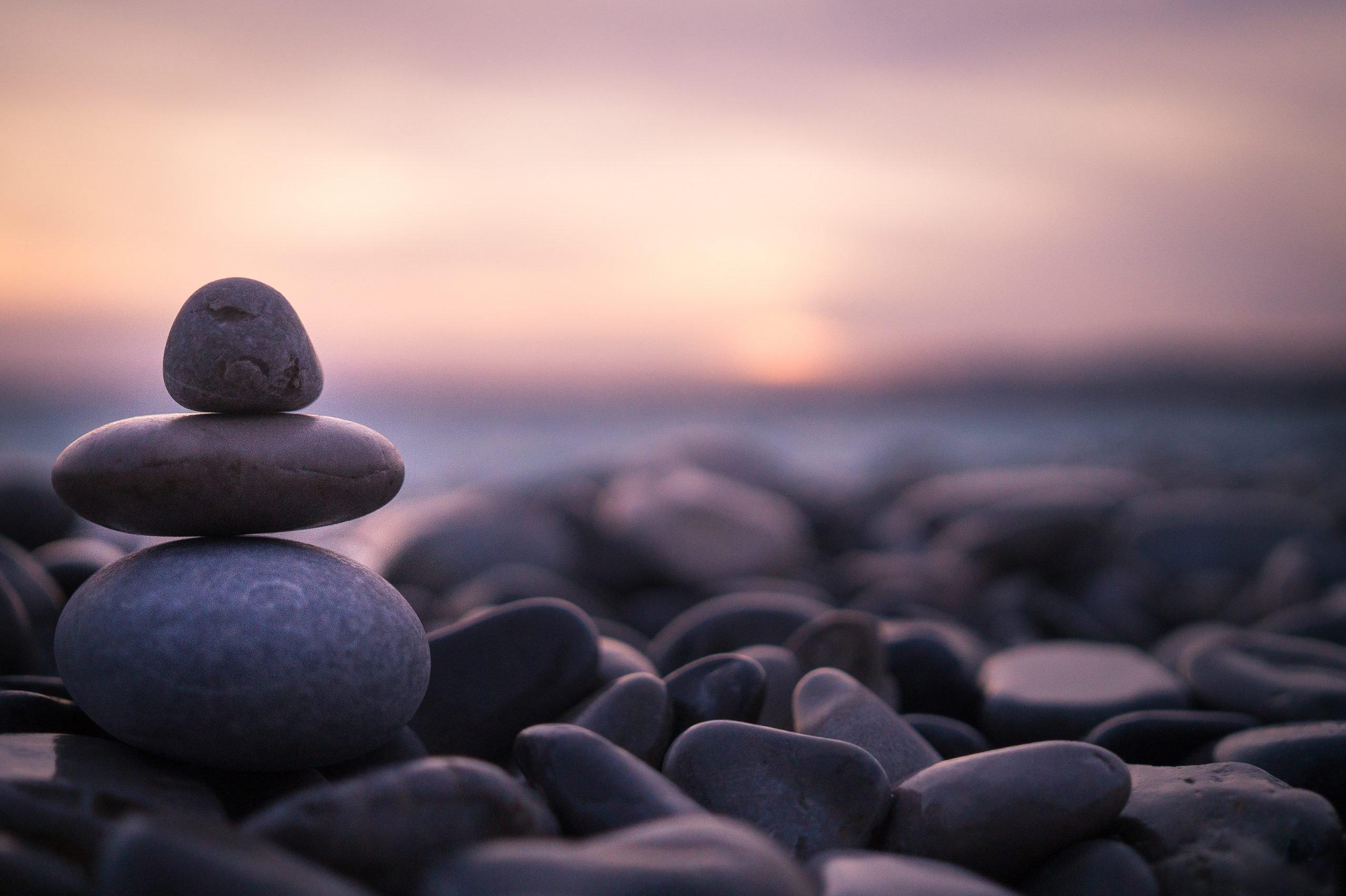 Sunset on pebbles on beach