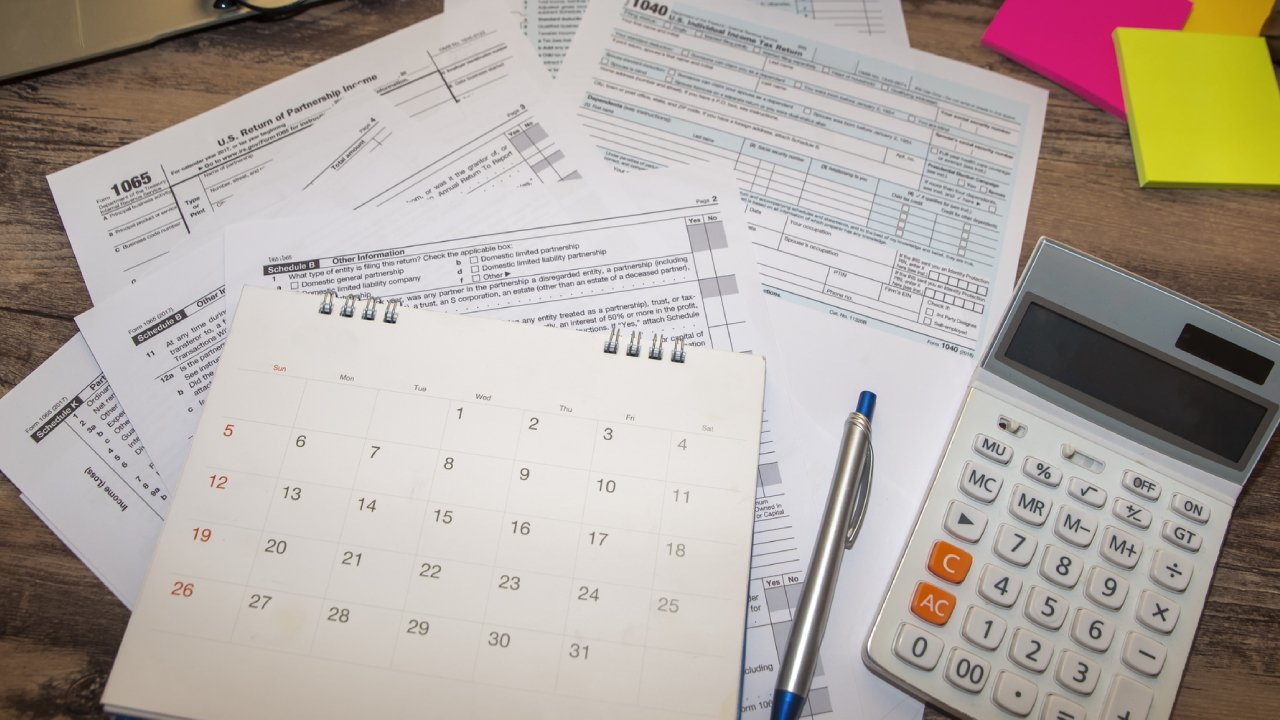 tax papers and calendar showing the end of the year